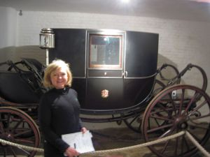 Cheryl takes notes about the carriages, including this crested coach, at the collection shown at Carlcotte Park in Warwickshire, England.