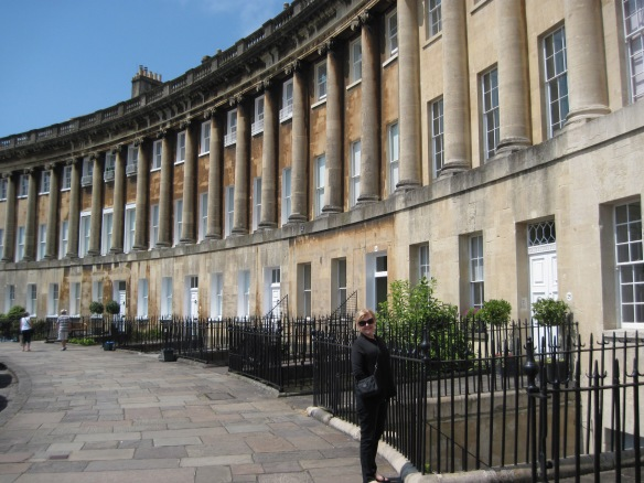 Cheryl Bolen standing in front of Bath's Royal Crescent.